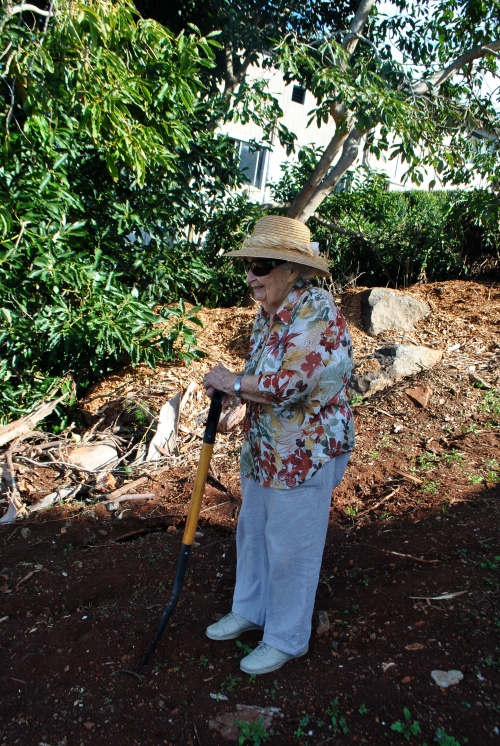 Tony's Mom on her land, helping to clean it up